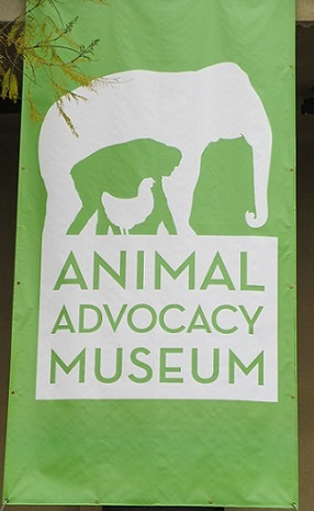 The Animal Advocacy Museum proudly displays its thought-provoking logo