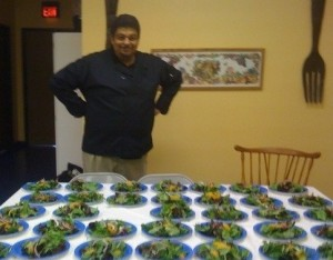 Chef Del appreciates the makings of meals for many visitors at Wellness Forum Foods