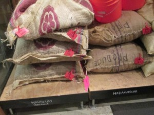 Each of these large bags of fermented cacao beans will make about 700 bars of dark chocolate