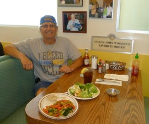 Robb, after deciding to go vegan, makes much healthier food choices in the same restaurant booth