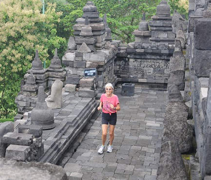 Dr. Ruth Heidrich, in one of her many adventures, runs through the Buddhist ruins in Borobudur, Indonesia