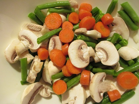 Listen to music while you chop the vegetables, and enjoy the colors of your food as well. Here are the mushrooms and other veggies I chopped for my recipe.