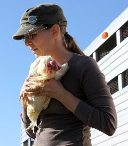 As a teen, Hope realized that she did not want to eat the chicken on her family's table. Here she comforts a rescued chicken
